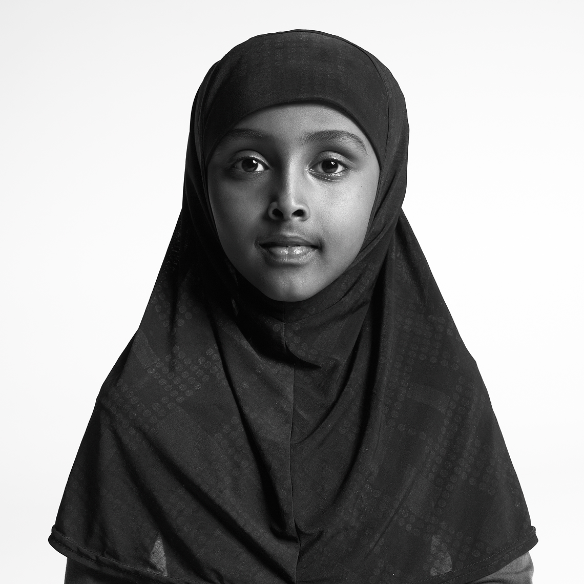 African American Girl in black hijab_black and white portrait