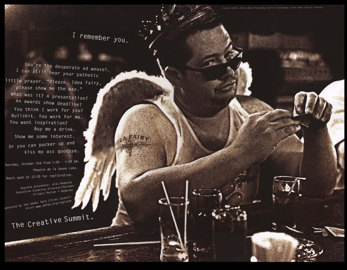 Man in a bar angel wings sunglasses drinks black and white