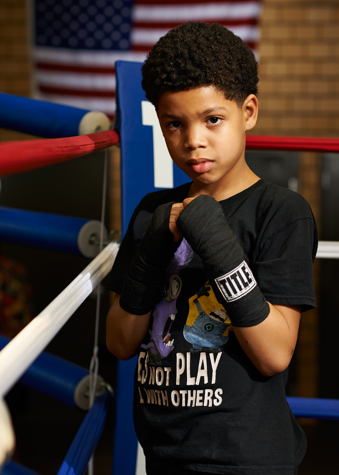 African American Boy in boxing wraps