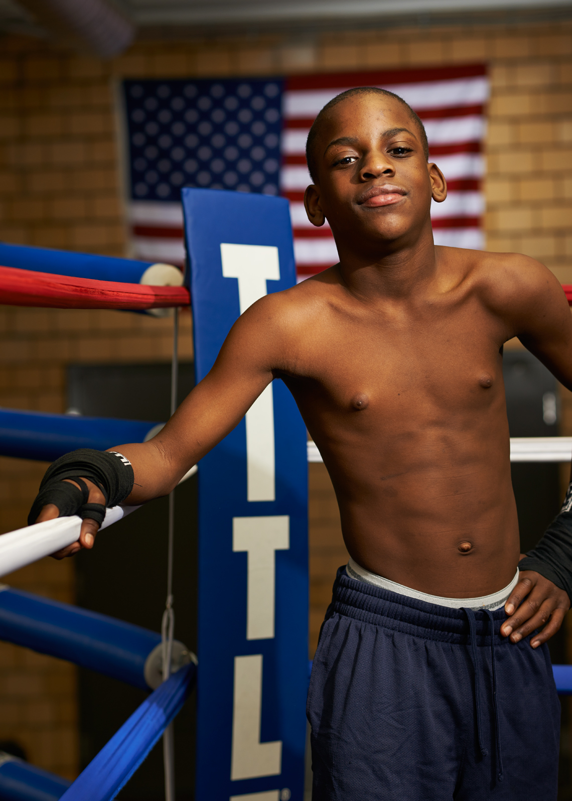 skinny african american boy in boxing ring