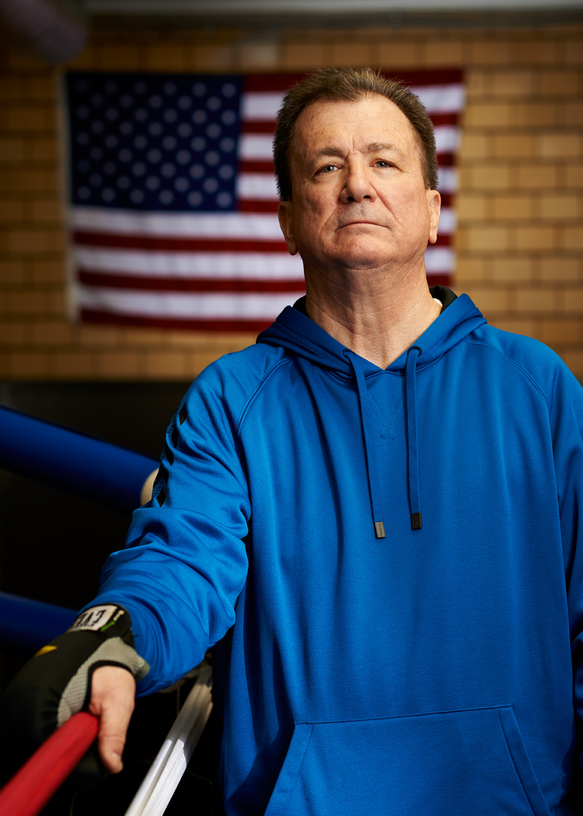 White Ex Cop Boxing Coach in Blue sweatshirt