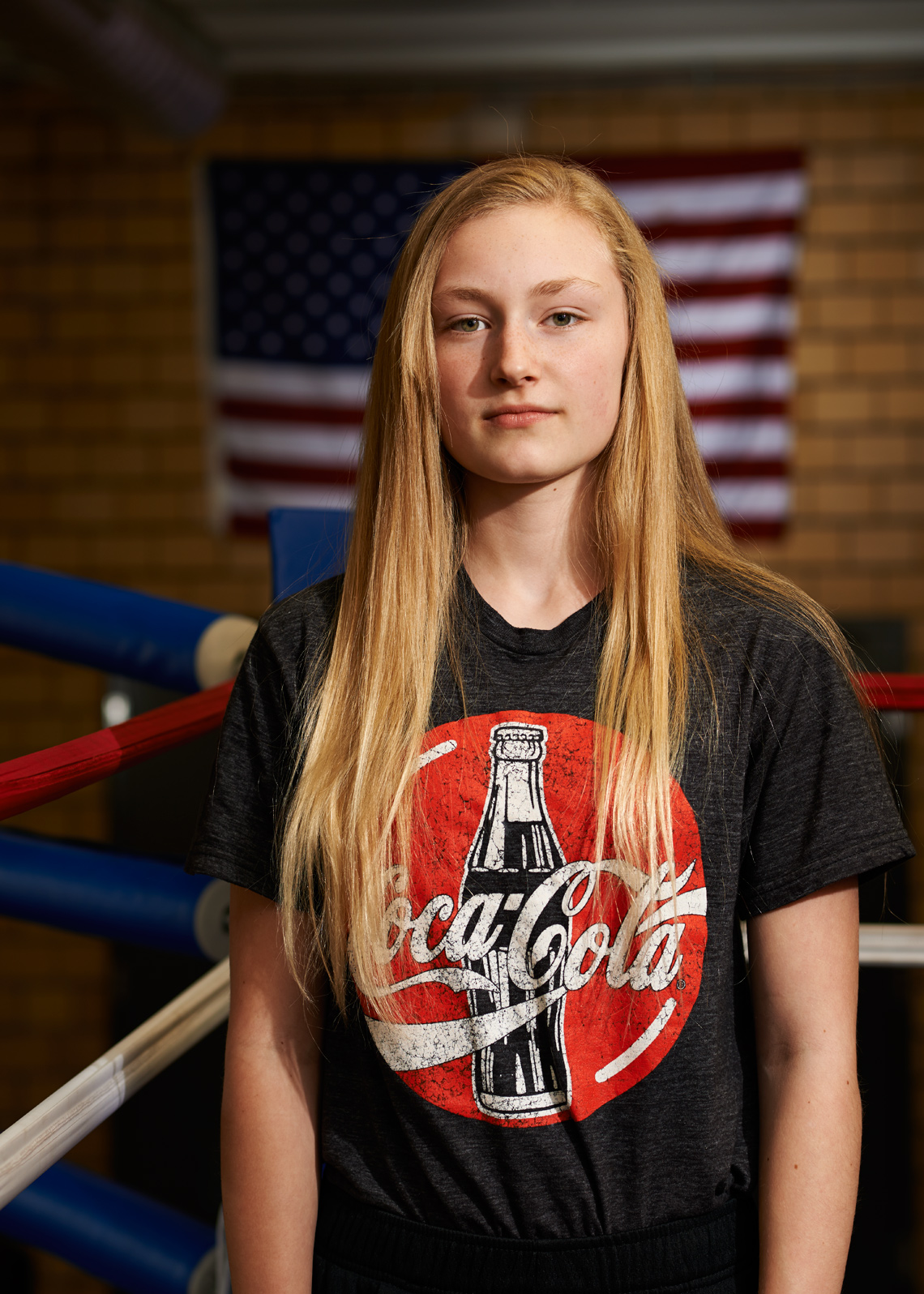 Blond teen girl in the boxing ring