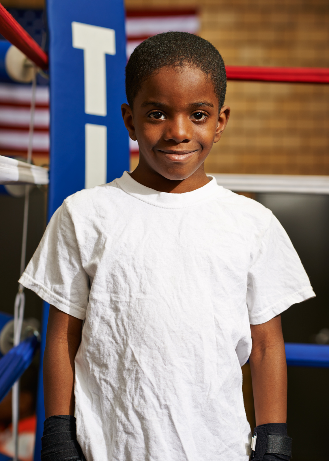 Cute African American Boy in a white tee shirt
