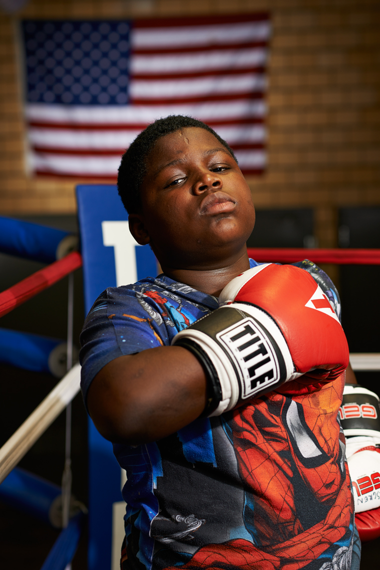 Young African American Boy, Boxing Gloves and Flag