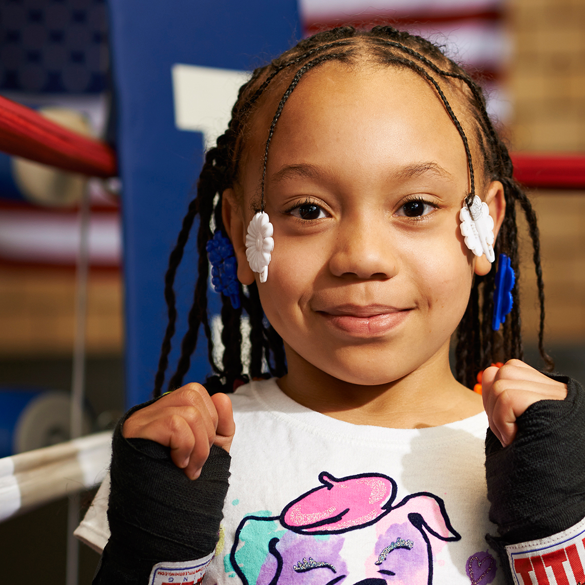 Sweet Little Girl Boxer with Beads and Braids