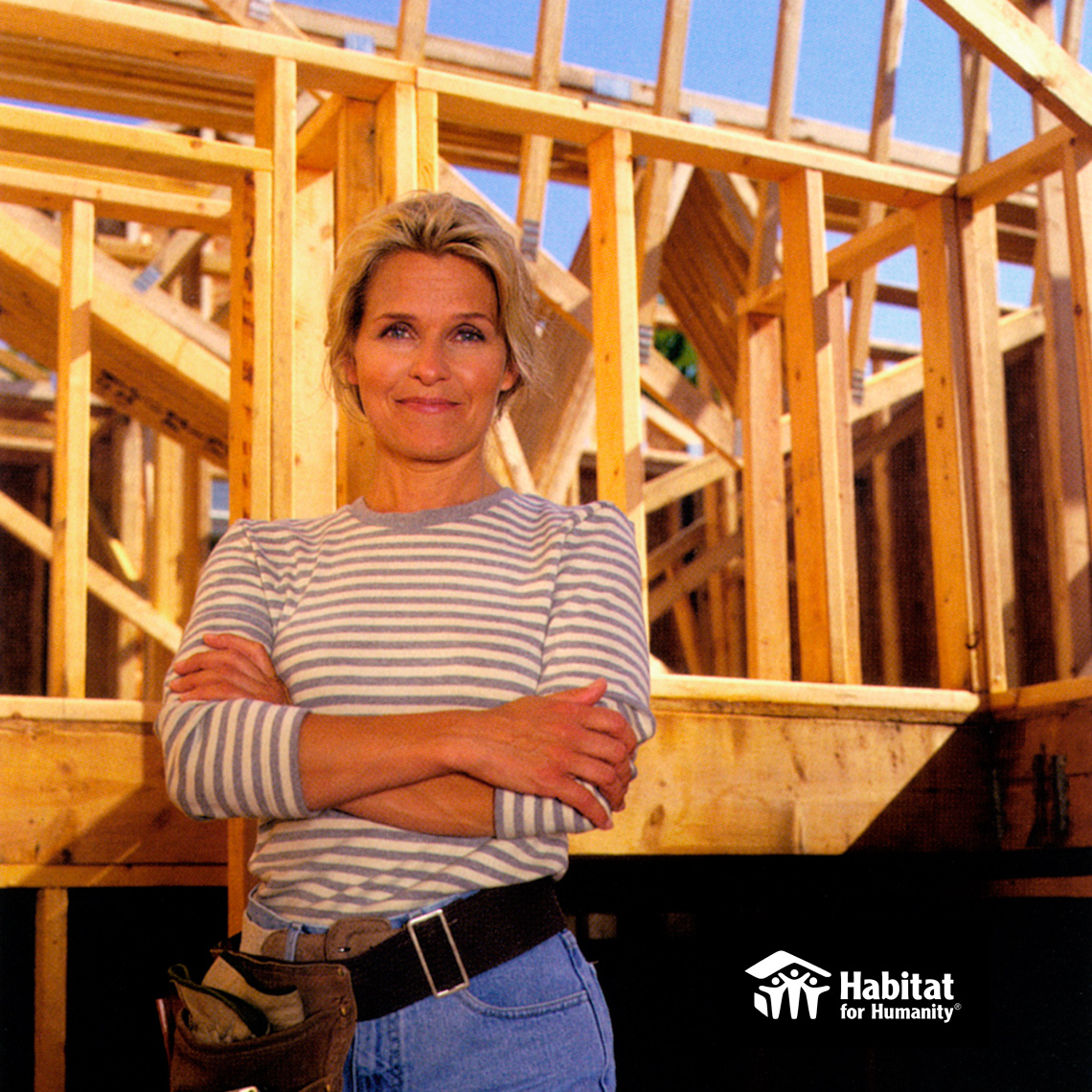 Habitat for Humanity Woman striped shirt arms crossed