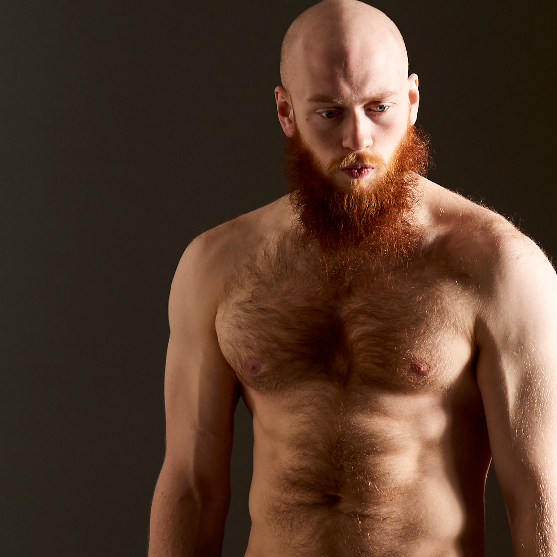Cooper topless muscular bald man with  hairy chest red hair